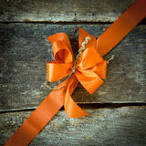 Diagonal orange ribbon on wood Stock Images