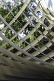 Diagonal patern. Diagonal metal pattern with tree background Royalty Free Stock Photo