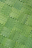 Diagonal pattern of woven grass leaves Stock Photo
