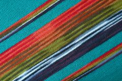 Free Diagonal Patterns And The Texture Of Turquoise Blue With Red And Green Striped Alpaca Knitted Wool Fabric Royalty Free Stock Images - 143948269