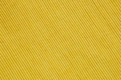 Diagonal Placemat Texture. Close-up of a yellow place mat texture for backgrounds Royalty Free Stock Photo