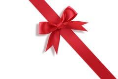 Diagonal red gift bow. On white background royalty free stock photo