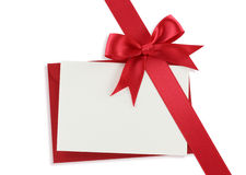Diagonal red gift bow. And blank card on white background stock image