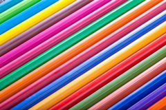 Diagonal row of colorful pencils Royalty Free Stock Images