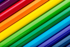 Diagonal row of colorful pencils Royalty Free Stock Photos