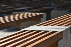 Free Diagonal Rows Of Simple Design Benches Made Of Wood And Concrete Royalty Free Stock Photography - 128852677