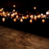 Diagonal wooden table with festive bokeh background Royalty Free Stock Image
