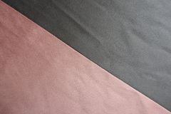 Diagonal seam between pink and grey artificial suede. Diagonal seam between pink and gray artificial suede Stock Photography