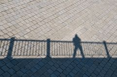 Diagonal shadow of a railing Royalty Free Stock Photo