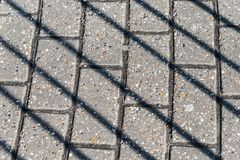 Diagonal shadows on the pavement royalty free stock photos