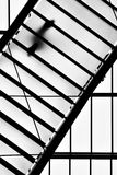 Diagonal stairs. Person on semi-transparent stairs, view from below royalty free stock photos