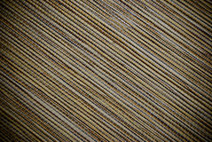 Diagonal striped wooden roller blind texture or background. Diagonal closeup of wooden roller blind royalty free stock photography