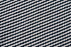 Diagonal stripes black grey. Close up of thin diagonal stripes black and grey, material cotton jersey Royalty Free Stock Photography