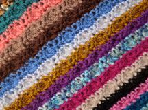 Diagonal stripes of crocheted stitches in multi-coloured wool ba. Diagonal stripes of crocheted stitches in multi-coloured wool, as abstract background texture royalty free stock photos