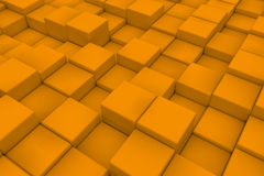 Diagonal surface made of orange cubes. Wall of cubes. Abstract background. 3d render Stock Photos