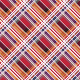 Diagonal tartan seamless texture mainly in warm hues Stock Photos