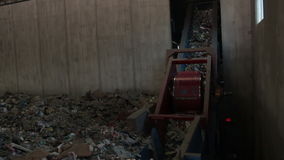 Diagonal trash conveyor belt (1 of 2). Environmental Recycling and Trash on a conveyor belt stock video