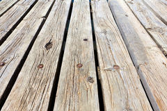 Diagonal view across wooden jetty Royalty Free Stock Images