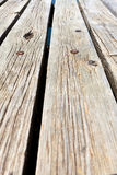 Diagonal view across wooden jetty Stock Images