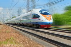 Diagonal view on high speed train runs on rail way tracks with motion blur effect background. Russian railways electric high speed Stock Images