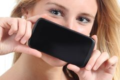 Diagonal view of a woman showing a black smartphone screen Royalty Free Stock Images