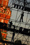 Diagonal view on workers on stage construction levels at Moscow Red Square in front of Vasiliy Blazhenniy Cathedral. Workers shado. W figures on staging Royalty Free Stock Images