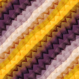 Diagonal violet and yellow chevron Stock Photography