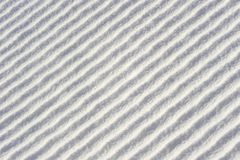 Diagonal waves (or ridges) in snow Royalty Free Stock Image