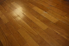Diagonal Wood Plank Floor. Section of varnished wood plank floor on a diagonal royalty free stock images