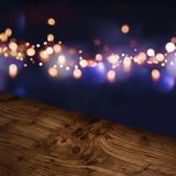 Diagonal wooden table top with blue illuminated background Stock Images
