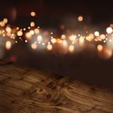Diagonal wooden table top with illuminated background Stock Photo