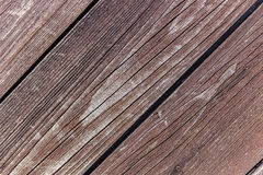 Diagonal wooden vintage planks closeup texture. Piece of brown wooden fence Stock Image