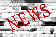 Diagonal word `News`  over newspapers background Royalty Free Stock Photos