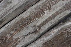 Diagonalbakgrund för tre gammal texturerad bräden Arkivbild