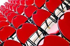 Diagonale rote Stühle Stockfotografie