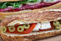 Diagonally one sandwich behind the other. 2 different sandwiches. royalty free stock photos