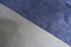 Diagonally sewn blue and grey artificial suede from above. Diagonally sewn blue and gray artificial suede from above Stock Photo
