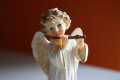 Diagram av en ängel som spelar flöjten arkivbilder