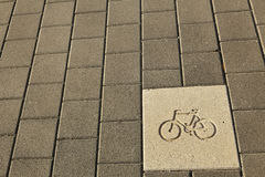 Bicycle Path Sign. Diagram of a bicycle engraved on the pavement, indicating it's a bicycle path Royalty Free Stock Photography