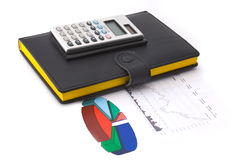Diagram and calculator. Calculator on a diagram with some graphs and data royalty free stock photo
