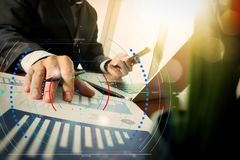 Businessman hand working with new modern computer and business s. Diagram of digital marketing media (website ad, email, social network, SEO, video, mobile app) Royalty Free Stock Photo