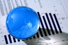 Diagram  and glassy globe.Finances concept Royalty Free Stock Image