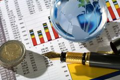Diagram   and glassy globe.Finances concept. Royalty Free Stock Image