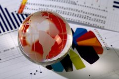 Diagram  and glassy globe.Finances concept Royalty Free Stock Photo