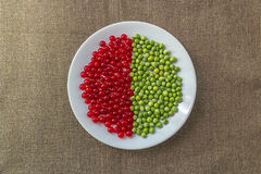 Diagram of red currant and green peas Royalty Free Stock Photography