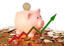 Diagram upwards with piggy bank Stock Photos