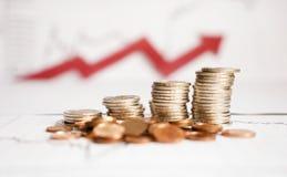 Diagrama en informe financiero, monedas del negocio Fotografía de archivo