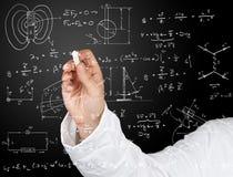 Diagramas y fórmulas de la física fotos de archivo libres de regalías