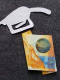 diagramet av pistolen av en bensin bombarderar i den vita och schweiziska sedeln av tio franc royaltyfri foto