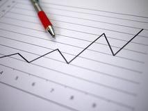 Diagramm und Feder Stockfoto